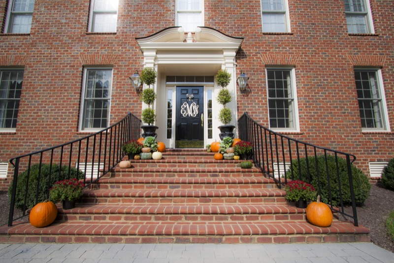 A gorgeous brick staircase decorated for fall.
