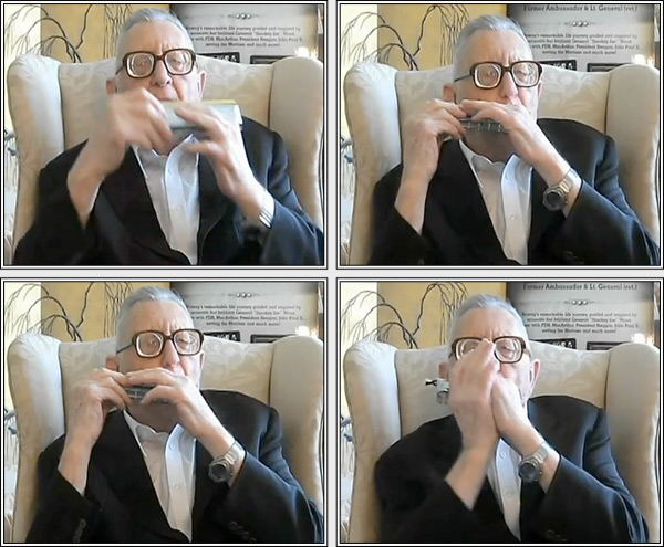 General Rowny playing the harmonica