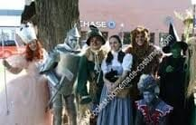 Hire OZ characters: Wicked Witch, Evil Winged Monkey, Scarecrow {OZ character}. Hire Tin Man, Hire Cowardly Lion {Wizard Of OZ} $125. - Same Day Singing Telegrams, Party Characters. Halloween Singing Telegrams: Wicked Witch, Wizard of OZ, Cowardly Lion, Scarecrow, Tin Man, Pink Gorilla, Evil Winged Monkey