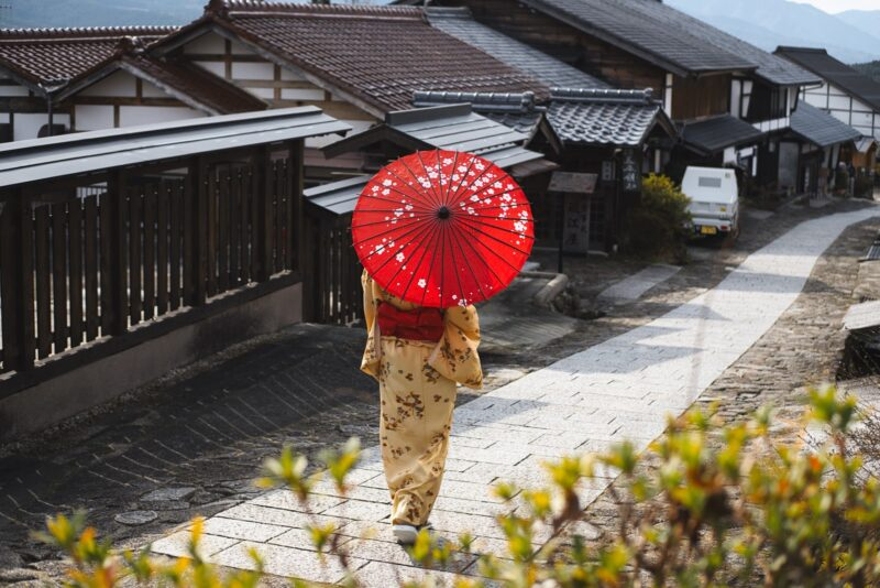 woman wearing a kimono with parasol