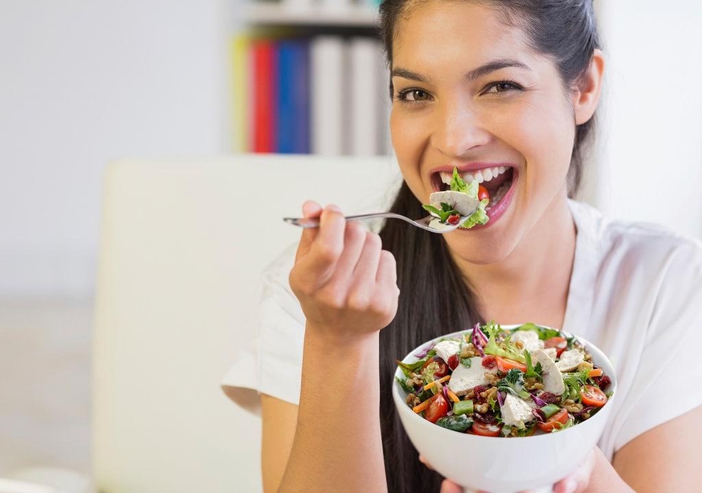 Woman-eating-Turkey-Cranberry-Salad