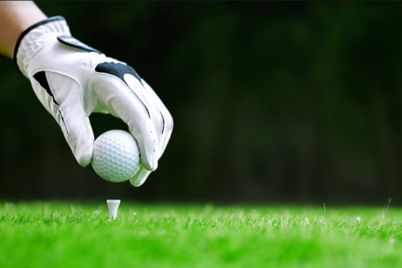 golf tee mans hand