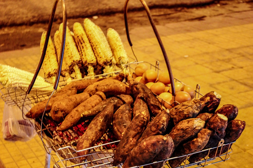 Sweet potatoes and corn-on-the-cob for sale at Night Market in Dalat, Vietnam