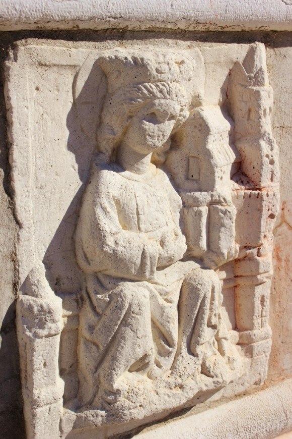 A stone carving of St. Euphemia near the church's side door in Rovinj Croatia