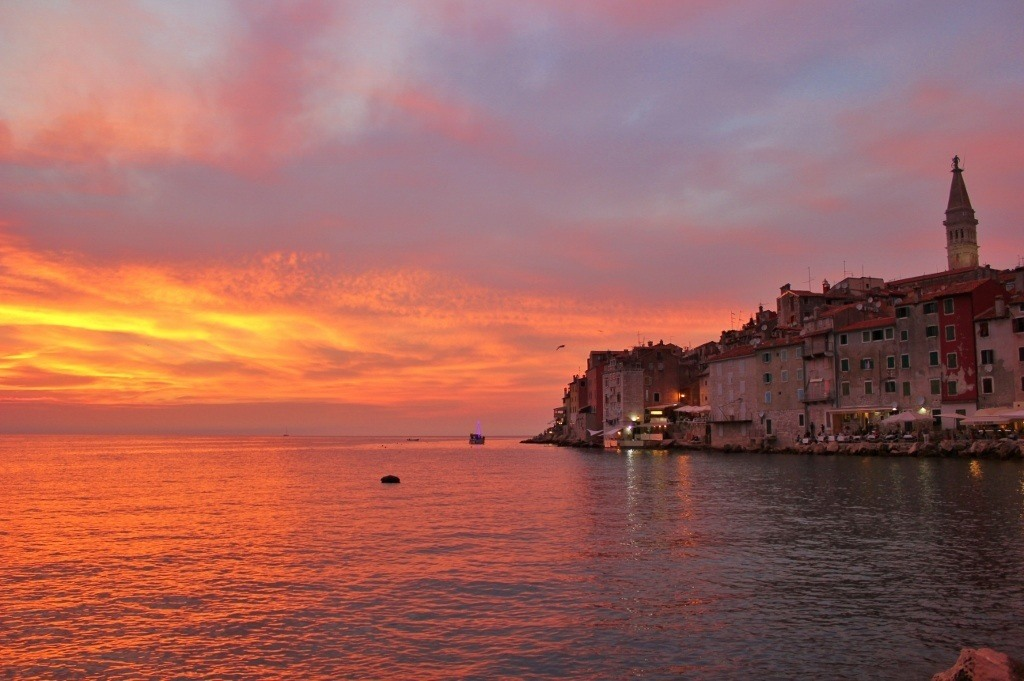The pier is a popular spot for sunsets in Rovinj, Croatia - with a view of the stunning old town, it is easy to understand why!