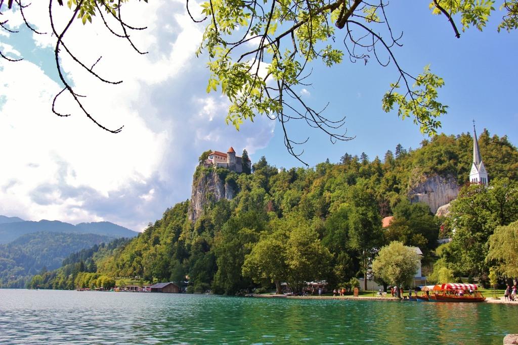 Lake Bled castle, Pletna boats, church spire