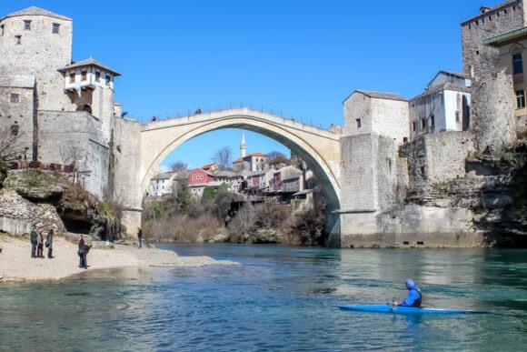 Kayak in water under Old Bridge in Mostar, Bosnia and Herzegovina