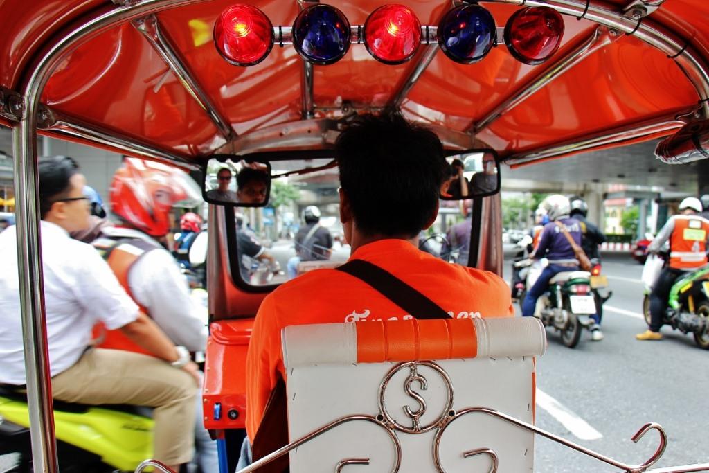 Riding in the back of a tuk tuk in Bangkok, Thailand