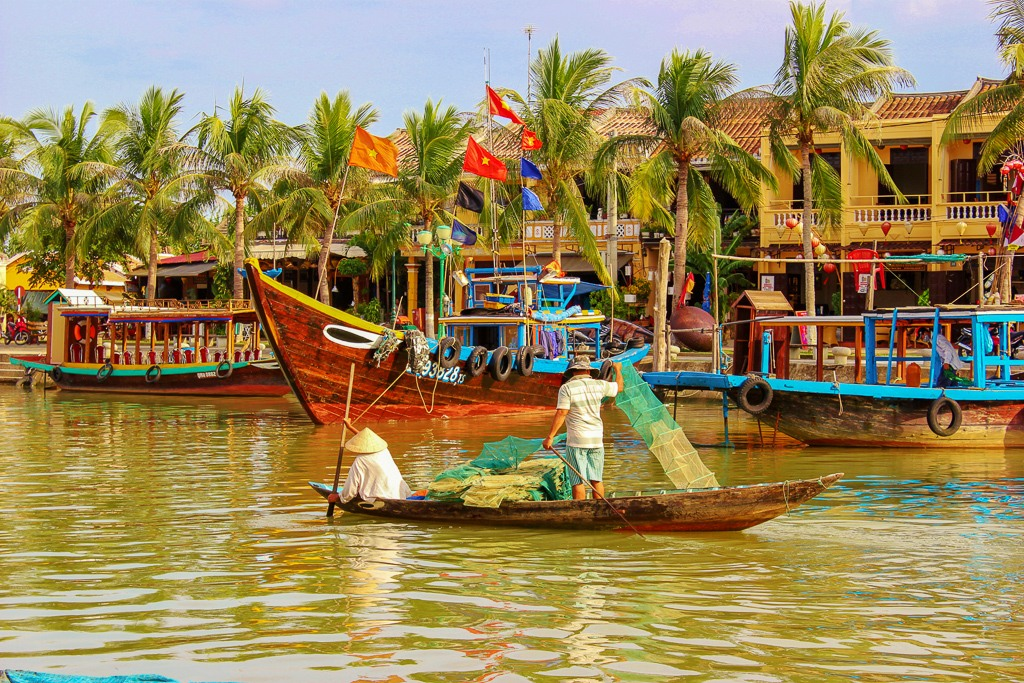 Fishermen on Thu Bon River in Hoi An, Vietnam