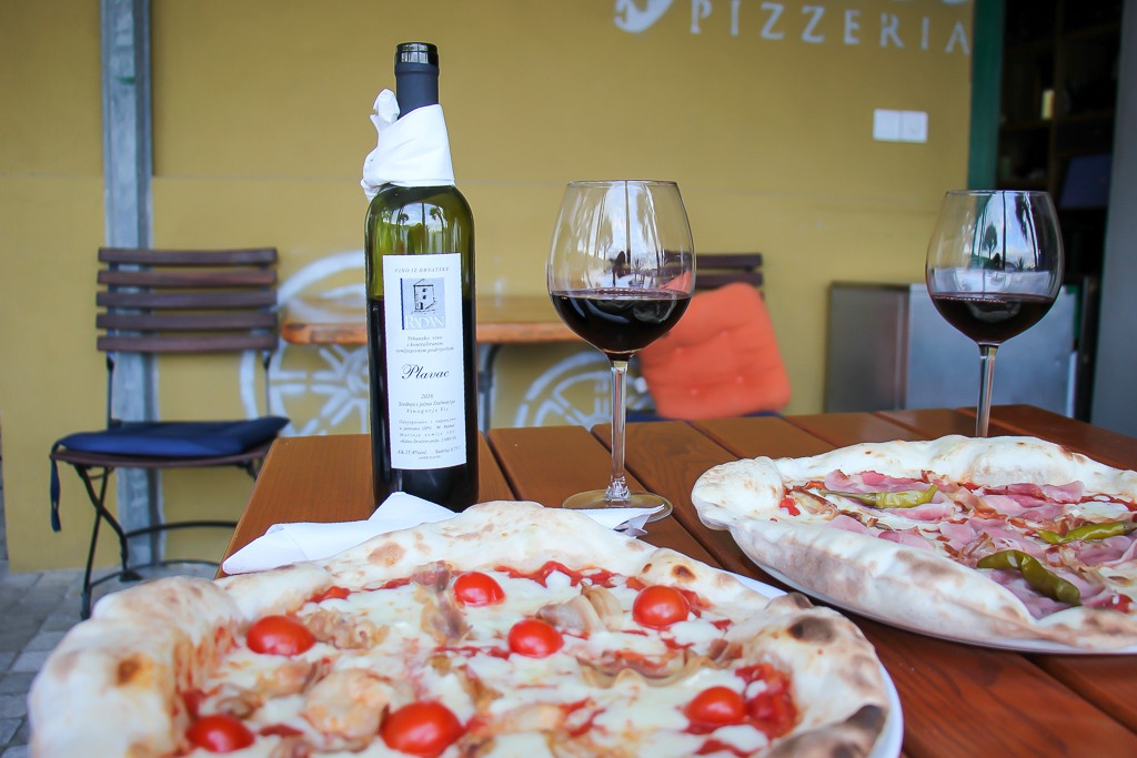 Pizza and wine at Pizzeria Karijola on Vis Island, Croatia