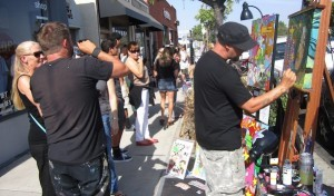 Adams Avenue sidewalks bustled with people and artists. (Photo by Cynthia Robertson)