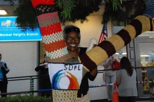 Volunteer Othella shows off her San Diego Public Library knit. (Courtesy Lynne Russo)