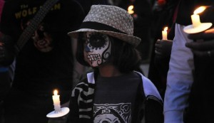 Unlike Halloween when people dress up in a variety of characters, this day calls for traditional or colorful garb and the painted skull face is done in tribute to lost loved ones. The living are honoring, celebrating and even laughing at death. (Courtesy Sandé Lollis)