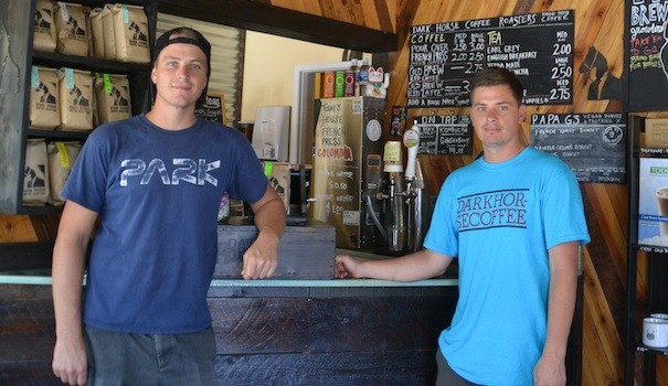 Daniel Charlson (right) opened Dark Horse Coffee Roasters on Adams Avenue in 2013. His brother, Bryan (left) later joined him in his venture. (Photo by Hoa Quach)