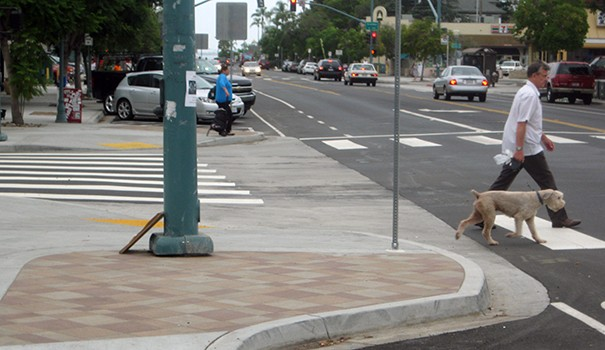 Improvements to 25th Street include pop-outs designed to protect pedestrians and calm traffic, plus enhanced crossings. (Photo by Dave Schwab)