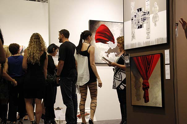 Patrons view artwork at the 2014 Art San Diego exhibition in Balboa Park. (Courtesy of Art San Diego)
