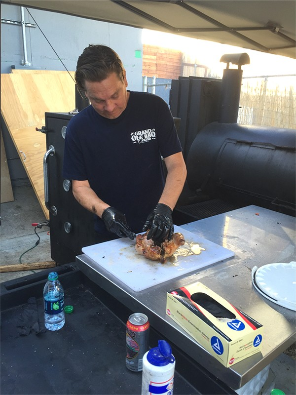 Owner Andy Harris splitting chicken at the cutting board (Photo by Frank Sabatini Jr.)