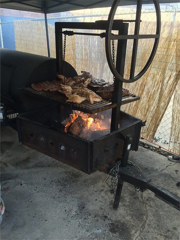 """The flame grill is active on """"Argentine Sundays"""" (Photo by Frank Sabatini Jr.)"""