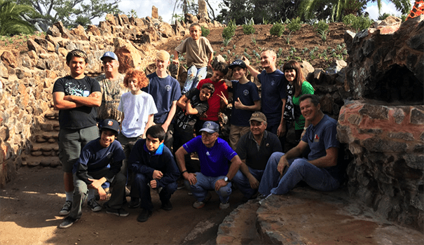 Will McCullough gives a thumbs-up to his fellow volunteers with Boy Scout Troop 53. His parents, Catherine and David, are first and second from right, back row. Scoutmaster Hank Levien is center, front row. (Courtesy of Catherine McCullough)