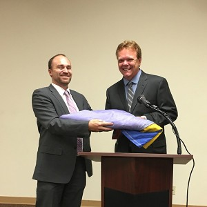 Ben Nicholls honors Terpstra with a rainbow flag (Courtesy of Hillcrest Town Council)