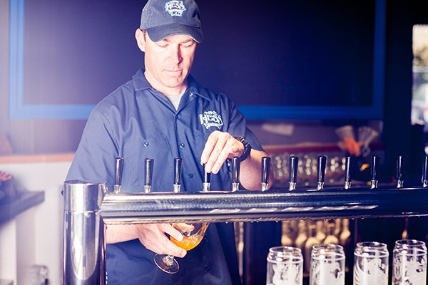 Mike Hess pours one of his craft beers. (Photo by Christopher Verdick at verdickmoja.com)