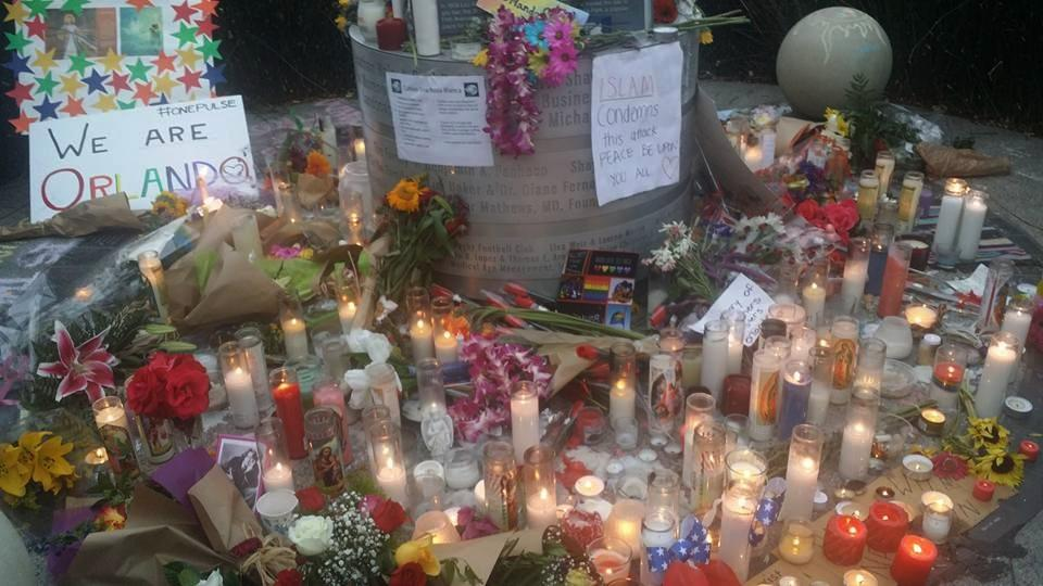A memorial grows at the base of the Hillcrest Pride Flag pole. (Photo by Morgan M. Hurley)