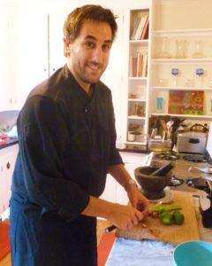 Chef Peter Calley preparing dinner in Audrey Jacobs' kitchen (Photo by Frank Sabatini Jr.)