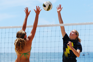 Sally Yingst and Carly Wopat play against each other on the beach this summer in a CBVA tournament