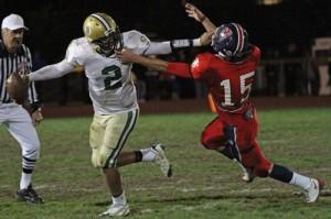 Santa Barbara quarterback R.J. Rosborough tries to fend off San Marcos defender Jake Buchanan