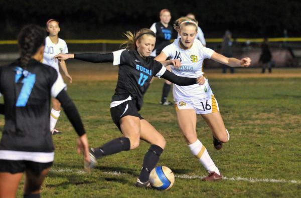 Santa Barbara High's Natalie Cvitanic hounds a Buena player in the midfield on Tuesday. (Presidio Sports Photo)