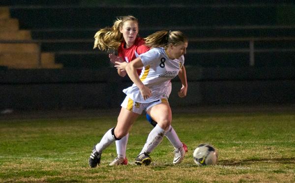 Santa Barbara's Megan Flynn gets around San Marcos defender Tasha Wood near the endline just before scoring the game's only goal. (Presidio Sports Photos)