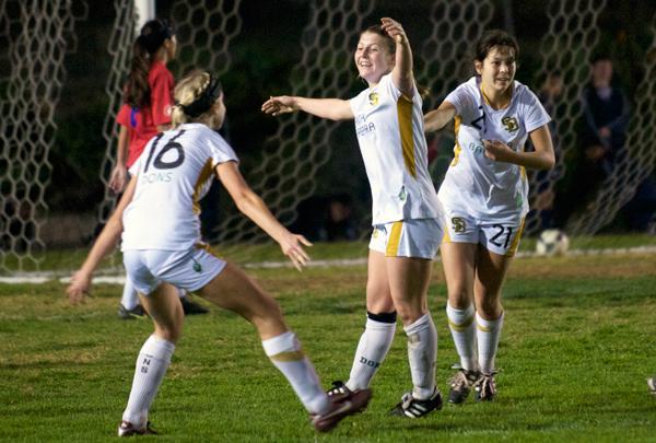 Santa Barbara's Megan Flynn, center, celebrates the game-winning goal with teammates Natalie Cvetanic, left, and Hannah Brisby, right.