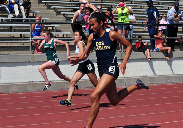 Emma Redick of Dos Pueblos wins her heat of the 100-meter dash at the 75th Easter Relays. Her time of 13.09 was fourth overall.