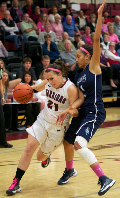 Westmont's Jillian Wilber drives to the basket on Friday and draws a shooting foul.