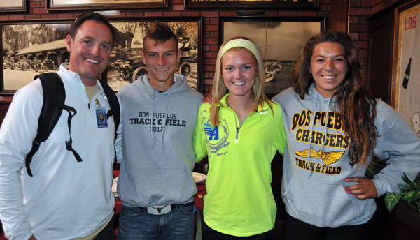 Dos Pueblos track & field coach Chris Mollkoy, left, with runners Max Davis, Addi Zerrenner, and thrower Stamatia Scarvelis.