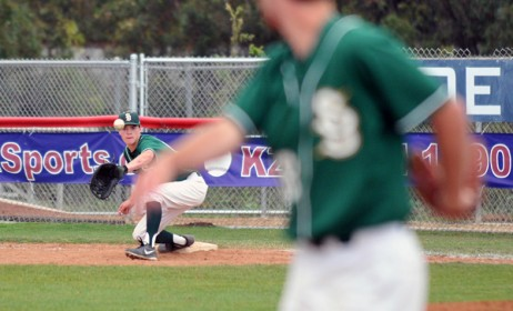 Dons third baseman Jeff Paschke (foreground) watches his throw reach the glove of first baseman Tyler Newman for an out in the sixth inning.