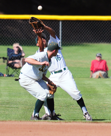Santa Barbara High's Zach Torres comes into to shallow right field to catch a pop-up over teammate Toby Minehan.