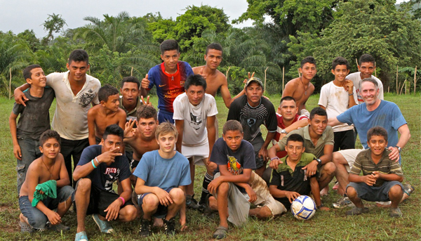 Jake Yanolly with fellow soccer players in Honduras