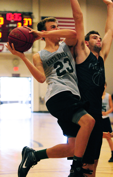 Santa Barbara High's Jack Baker, pictured driving to the basket during a summer league game, is a returning First Team All-Channel League player for the Dons. (Presidio Sports Photo)