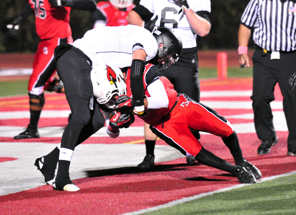Abel Gonzalez of Bishop Diego fights his way into the end zone for the Cardinals' first touchdown of the game. (John Dvorak photo)