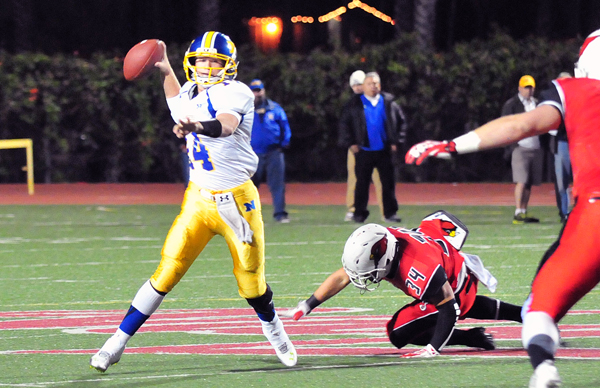 Nordhoff quarterback Tanner Workman eludes a Bishop Diego defender while looking for an open receiver.