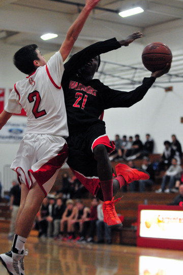 Bryson Frazer of Carpinteria attacks the rim against Bishop Diego's Jason Price. Frazer scored 33 points, but Bishop Diego won the game, 67-61.