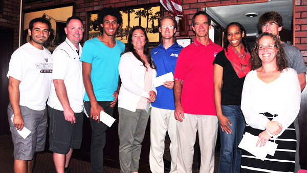 Local prep and college track coaches received checks from the Santa Barbara Athletic Association for their work on the Santa Barbara International Marathon.