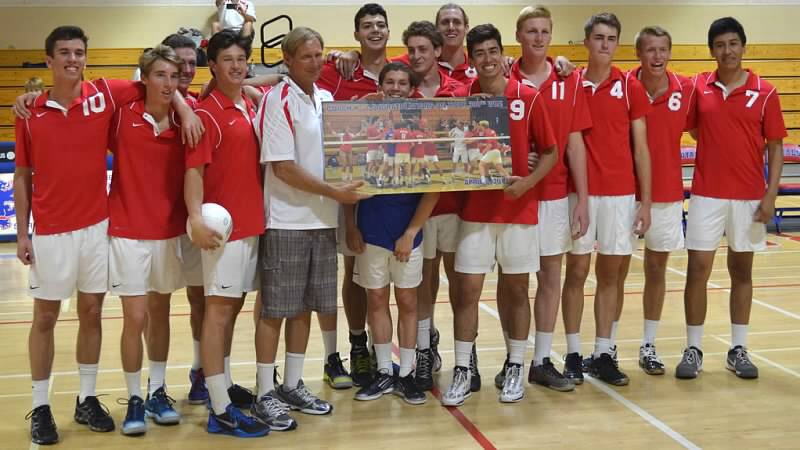 In honor of his 300th win as a volleyball coach, Roger Kuntz is presented a photo of his San Marcos team winning the Dos Pueblos Invitational.