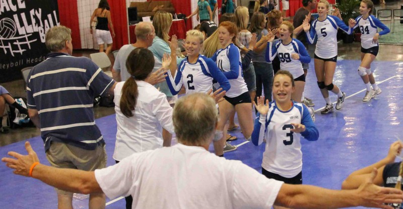 The 13-Blue team of the Santa Barbara Volleyball Club does a victory lap at the Volleyball Festival in Phoenix, Ariz.