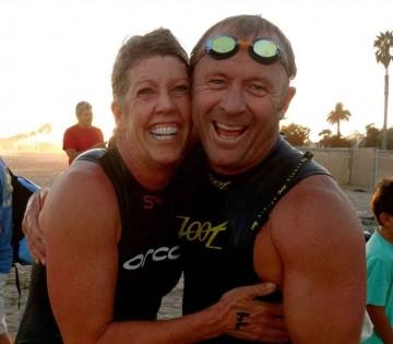 Women's winner Vicki Mills hugs fellow county firefighter Jon Ford.