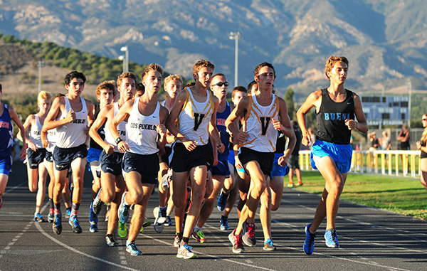 Kaleb Kunes, right, won the first Channel League cross country race of the season on Wednesday.