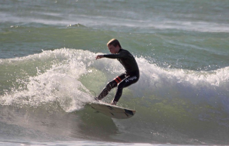 Curtis Jacobs cuts back on a wave during the NSSA Gold Coast Conference meet at Ventura's C Street. (Photo by Chris Keet, Surf Happens)