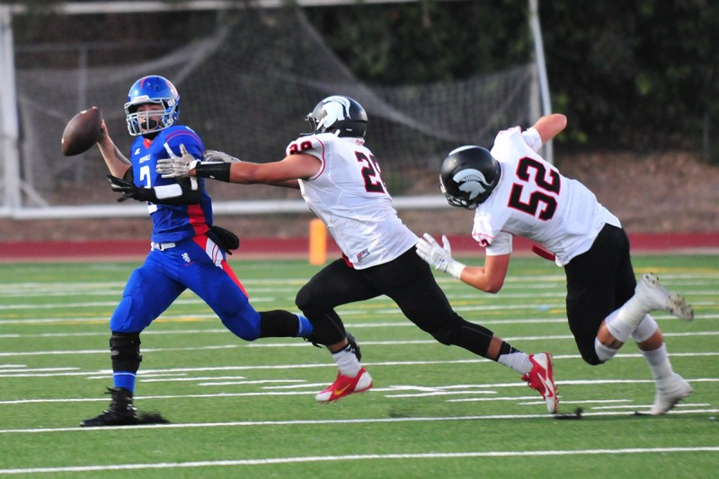 San Marcos' Sage Reid, here evading the Rio Mesa pass rush, made his first start of the season on Friday.