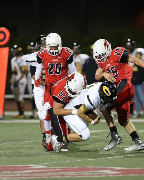 Sam Grimm (62) records one of his three sacks on Cabrillo quarterback Brett Gregory. (Janice Gram photo)